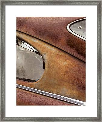 Shot Through The Back Windwo Framed Print by Jean Noren