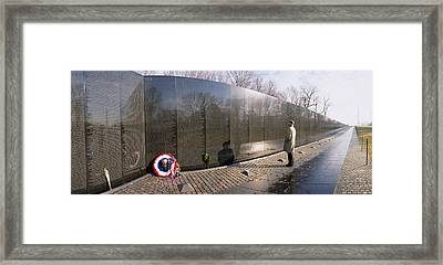 Side Profile Of A Person Standing Framed Print by Panoramic Images