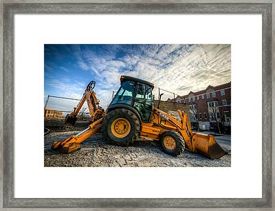 Side View Of A Backhoe At Sunset Framed Print by Anthony Doudt