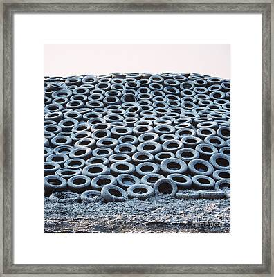 Silage Heap With Snow-covered Tires Framed Print by Nigel Cattlin