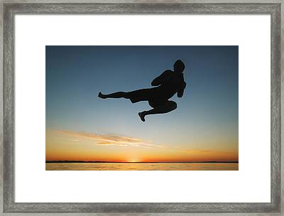 Silhouette In The Sunrise Framed Print by Don Hammond