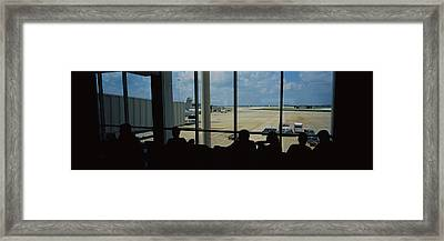 Silhouette Of A Group Of People At An Framed Print by Panoramic Images