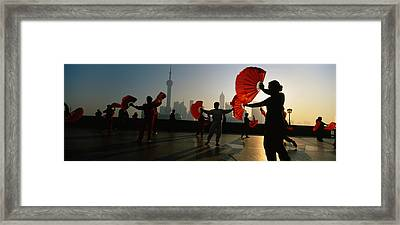 Silhouette Of A Group Of People Dancing Framed Print by Panoramic Images