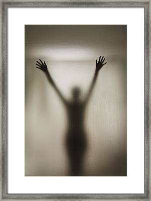 Silhouette Of A Nude Woman Behind The Framed Print by Perry Mastrovito
