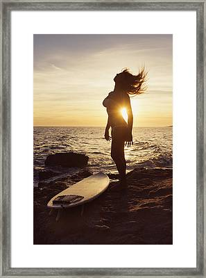 Silhouette Of A Woman Standing Framed Print by Ben Welsh
