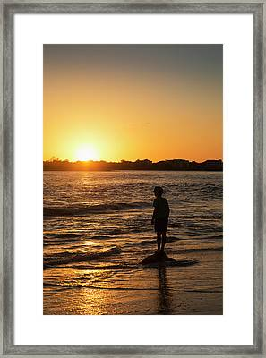 Silhouette Of A Young Boy Standing Framed Print by John Short