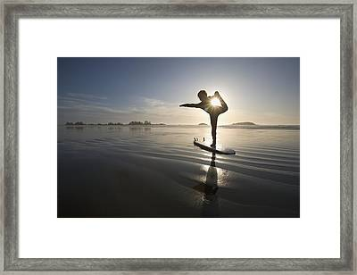 Silhouette Of Female Surfer Doing Bow Framed Print by Deddeda