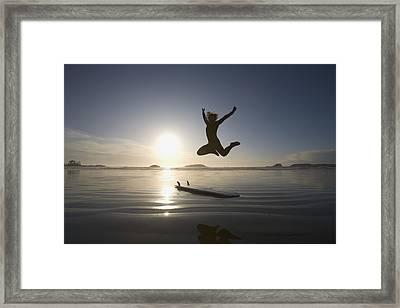 Silhouette Of Female Surfer Jumping For Framed Print by Deddeda