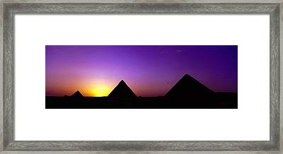 Silhouette Of Pyramids At Dusk, Giza Framed Print by Panoramic Images