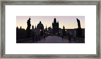 Silhouette Of Statues On Charles Bridge Framed Print by Panoramic Images