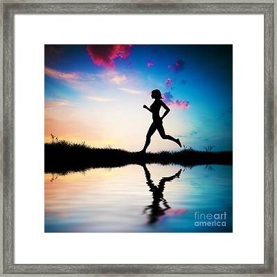 Silhouette Of Woman Running At Sunset Framed Print by Michal Bednarek