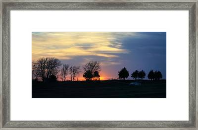 Silhouetts Of A Sunset Framed Print by Joan Bertucci