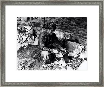 Silversmith At Work Framed Print by William J Carpenter