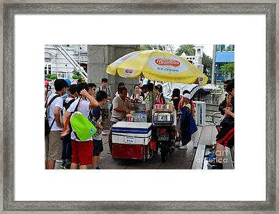 Singapore Ice Cream Man And Bicycle Swamped By Students Framed Print by Imran Ahmed