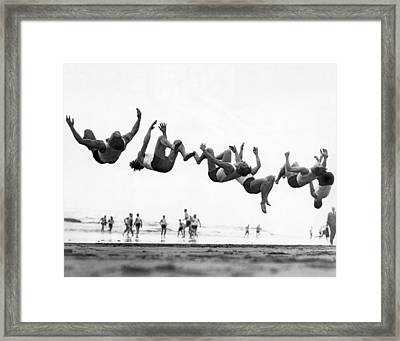 Six Men Doing Beach Flips Framed Print by Underwood Archives