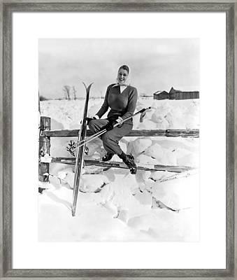 Skier Takes Sunshine Break Framed Print by Underwood Archives