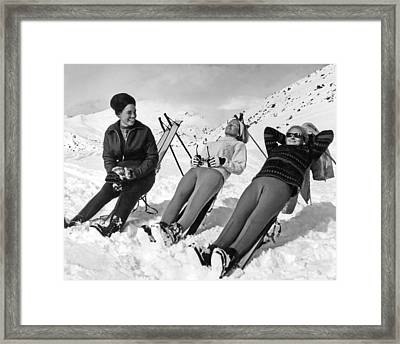 Skiers Basking In The Sun Framed Print by Underwood Archives