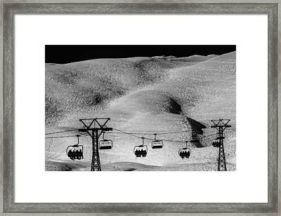 Skiing In Space Framed Print by Justin Albrecht