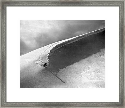 Skiing Under A Curl Framed Print by Underwood Archives