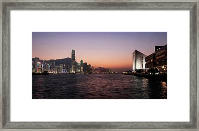 Skyline At Waterfront During Dusk Framed Print by Panoramic Images