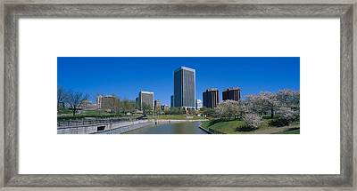 Skyscrapers Near A Canal, Browns Framed Print by Panoramic Images