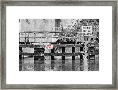 Slow No Wake Framed Print by Earl Ball