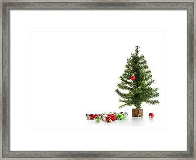 Small Artifical Tree With Ornaments On White Framed Print by Sandra Cunningham