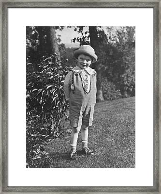 Small Boy Poses In Yard Framed Print by Underwood Archives