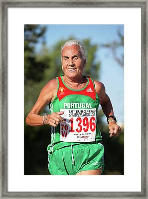 Smiling Silver-haired Female Athlete Framed Print by Alex Rotas