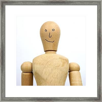 Smiling Wooden Figurine Framed Print by Bernard Jaubert