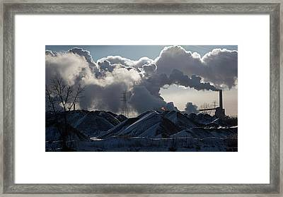 Smoke Rising From A Steel Mill Framed Print by Jim West