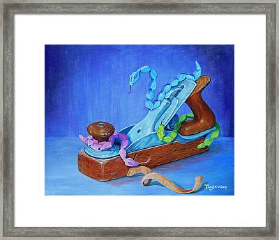 Snakes On A Plane Framed Print by Tanja Ware