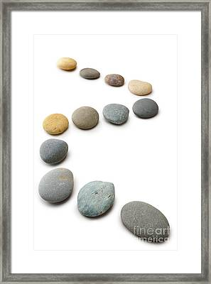 Snaking Line Of Twelve Pebbles Steps Isolated Vertical Framed Print by Colin and Linda McKie