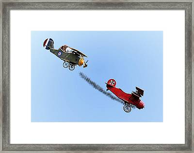 Snoopy And The Red Baron Framed Print by Kristin Elmquist