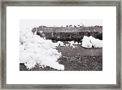 Snow By The Kerb Framed Print by Tom Gowanlock