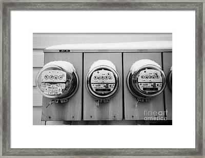 snow covered electricity meters in Saskatoon Saskatchewan Canada Framed Print by Joe Fox