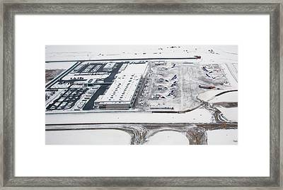 Snow-covered Fedex Terminal Framed Print by Jim West