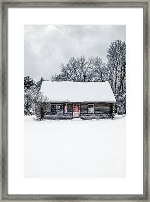 Snow Covered Log Cabin Framed Print by Edward Fielding