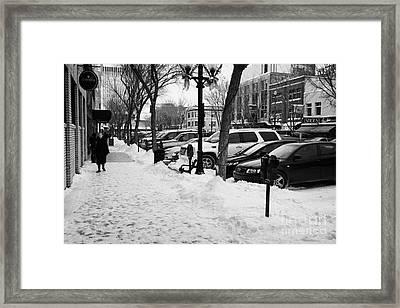 snow covered sidewalk in downtown Saskatoon Saskatchewan Canada Framed Print by Joe Fox