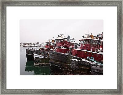 Snow Covered Tugs Framed Print by Eric Gendron