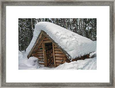 Snow Covered Wood Cabin Framed Print by Lilach Weiss