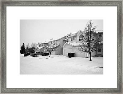 snow falling in residential street during winter Saskatoon Saskatchewan Canada Framed Print by Joe Fox