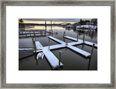 Snow On The Docks Framed Print by Eric Gendron