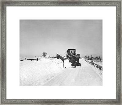 Snow Plow Clearing Roads Framed Print by Underwood Archives