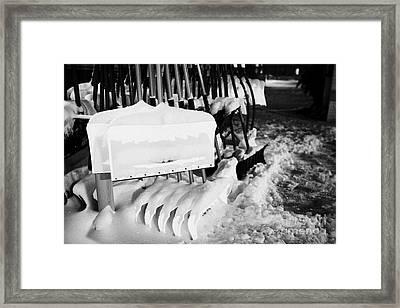snow shovels and scoops for sale outside store in Saskatoon Saskatchewan Canada Framed Print by Joe Fox