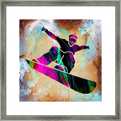 Snowboarding Down A Snow Covered Mountain Framed Print by Marvin Blaine