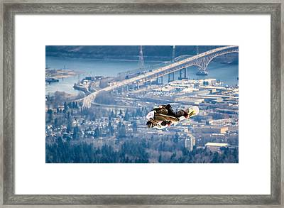 Snowboarding Over The City Framed Print by Alexis Birkill