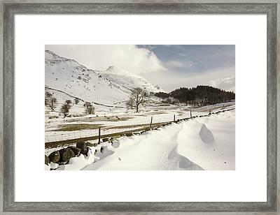 Snowdrifts Below Helvellyn Framed Print by Ashley Cooper