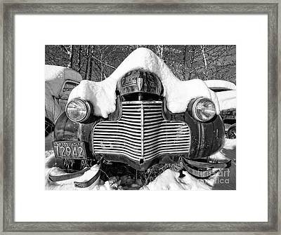 Snowed In A Thick Blanket Of Snow Covering A Vintage Chevy Framed Print by Edward Fielding
