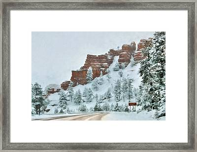 Snowy Red Canyon Framed Print by Lori Deiter
